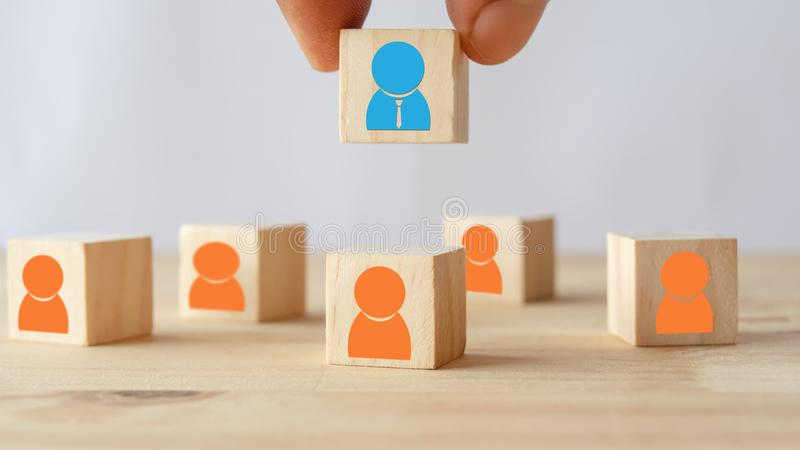 Hand put ,pick or choose the one who got idea or special or right man for job than other in human resources management hrm or re royalty free stock images