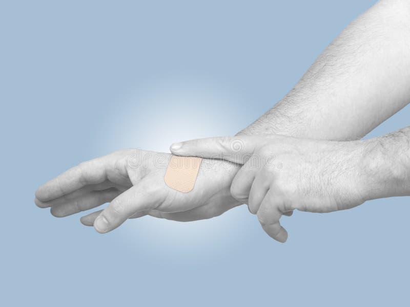 Hand Putting Adhesive Bandage Isolated On White Stock Image