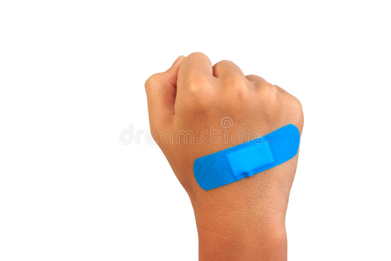 Hand putting adhesive bandage or plaster, band-aid on a cut. Isolated on white royalty free stock image