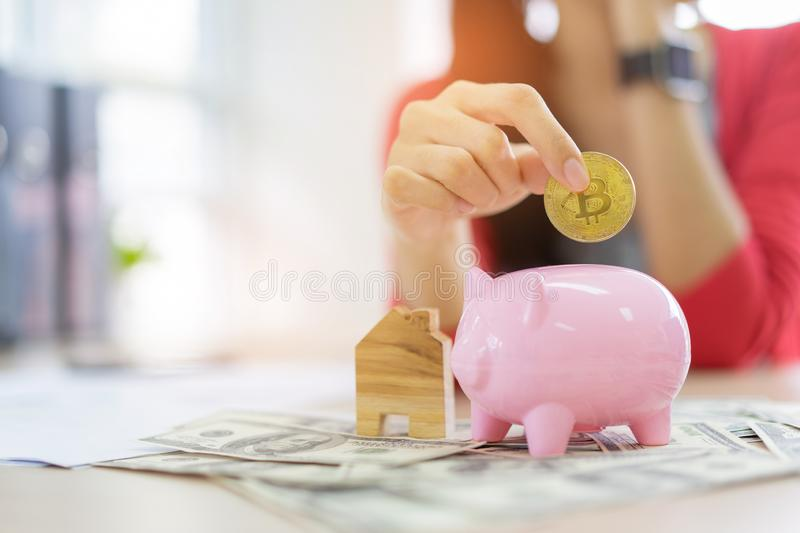 Hand putting coin money to piggy bank saving, save money concept. Real estate sale, home savings, loans market concept royalty free stock photos