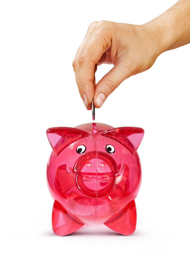 Download Hand Putting Coin Into Piggy Bank Stock Image - Image: 29014989