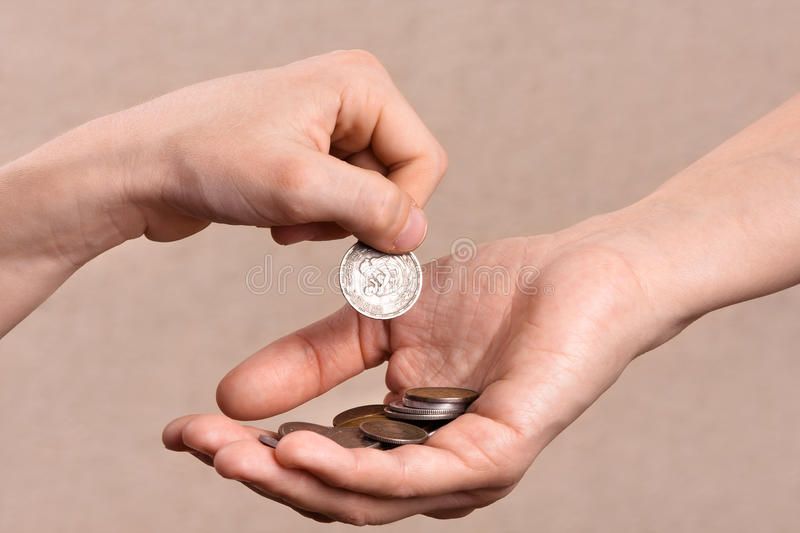 Download Hand Putting Coins In The Palm Of Another Person, Closeup Stock Photo - Image: 67381878