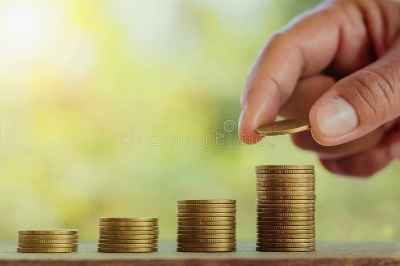 hand putting coins on stack for saving money business concept on royalty free stock photo