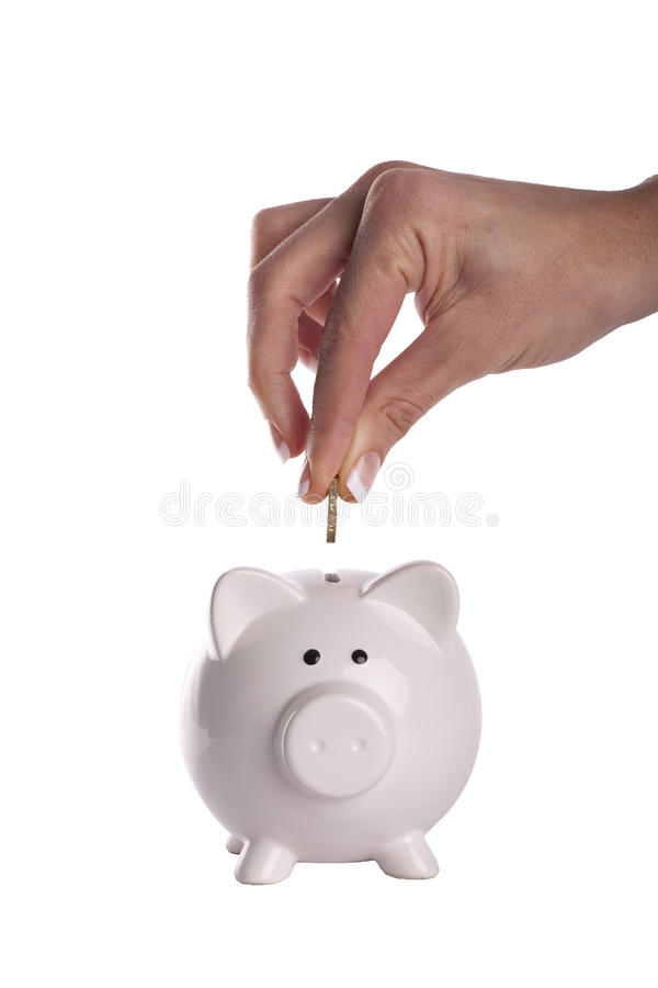 Download Hand Putting Money In Piggy Bank Stock Photo - Image: 20831476