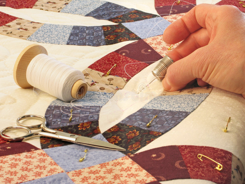 Hand quilting. Of double wedding ring patterned quilt royalty free stock image