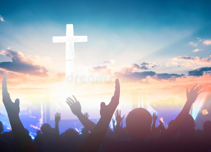 Worship and praise concept: christian people hand rising on sunset background. Hand Reach Sky In Silhouette Against Sunset stock photos