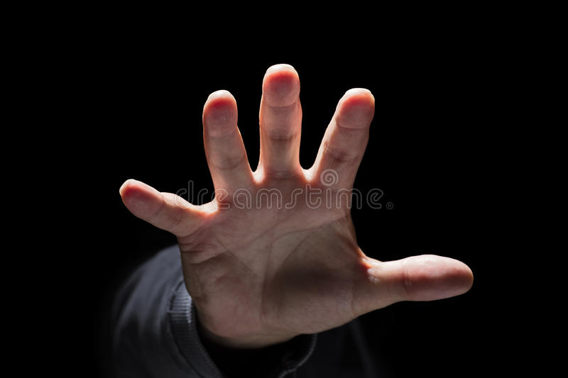 Hand reaching or attacking. Hand reaching from the dark and grabbing or attacking concept for fear, domestic and child abuse royalty free stock photos