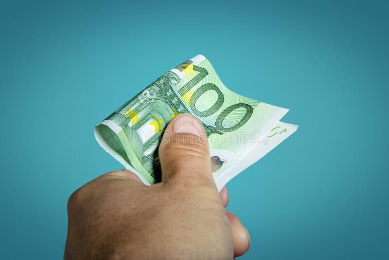 Hand reaching money stock photo