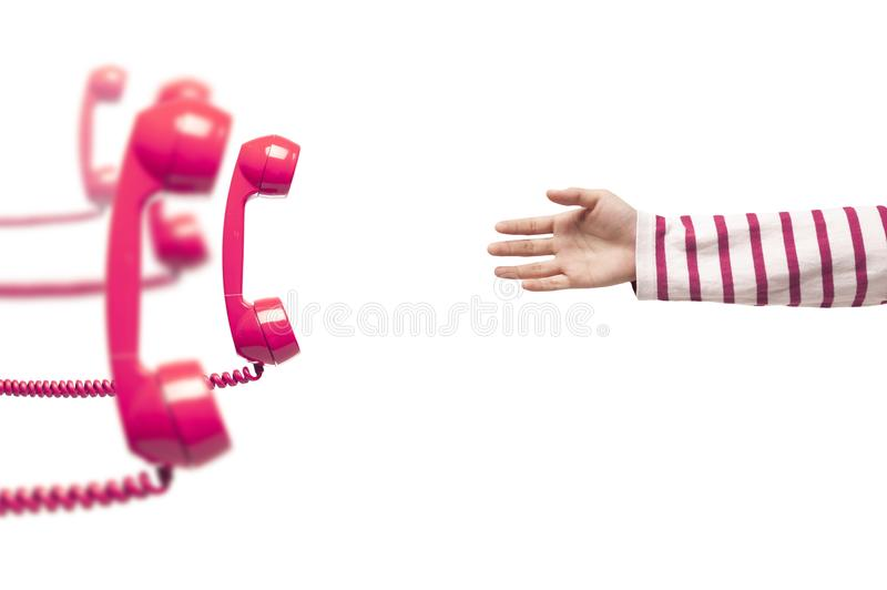 Hand reaching pink telephone royalty free stock photography