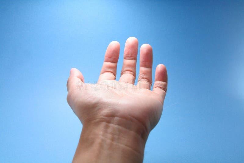 Hand reaching to sky stock photos