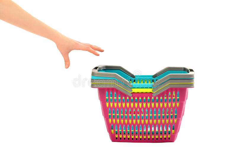 Hand reaching to take a shopping basket. royalty free stock photography