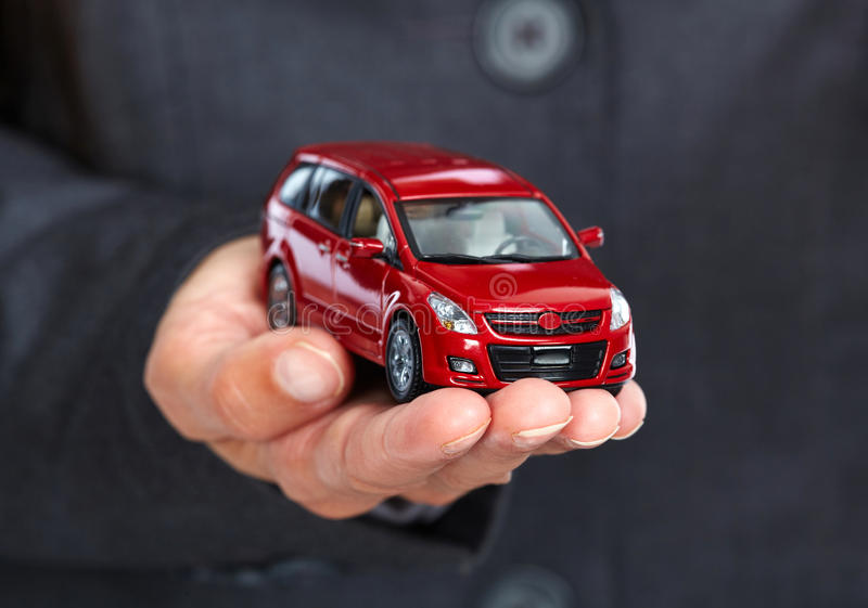 Hand with red car. royalty free stock photo