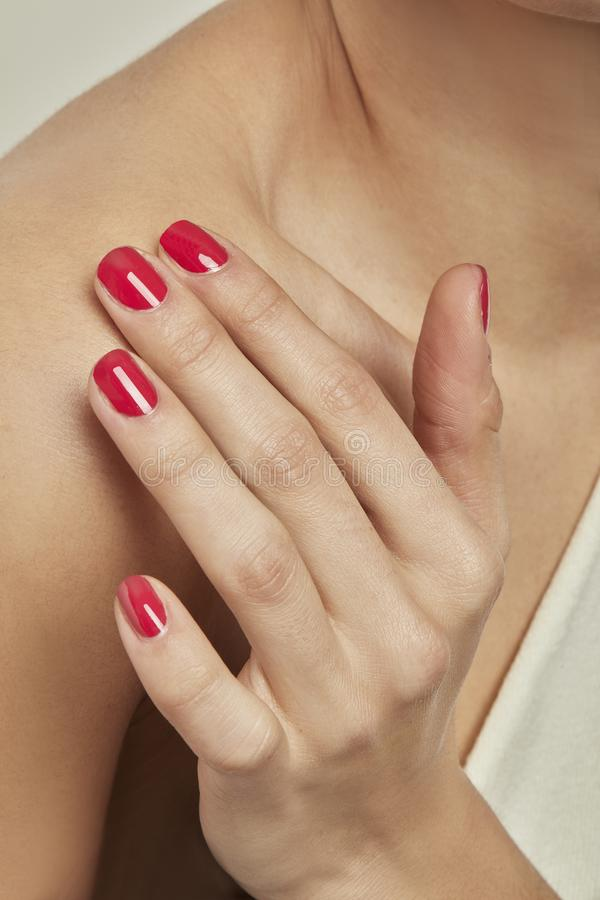 HAND WITH RED NAIL POLISH royalty free stock images