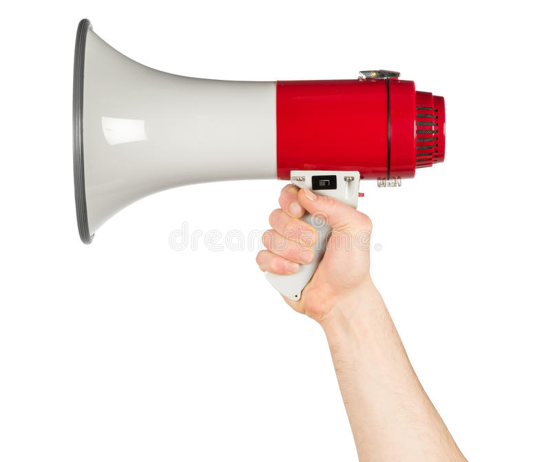 Hand with red white bullhorn megaphone. Isolated background royalty free stock photo