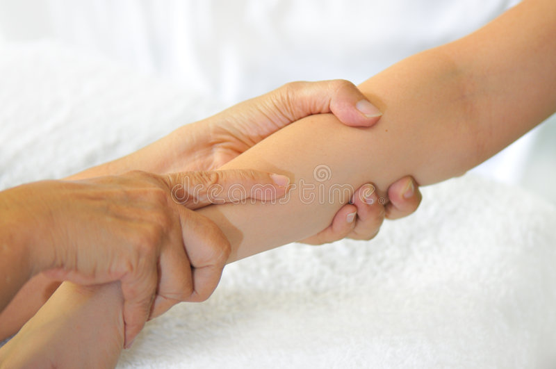 Hand Reflexology Series 6. A young lady getting a hand reflexology massage royalty free stock photos