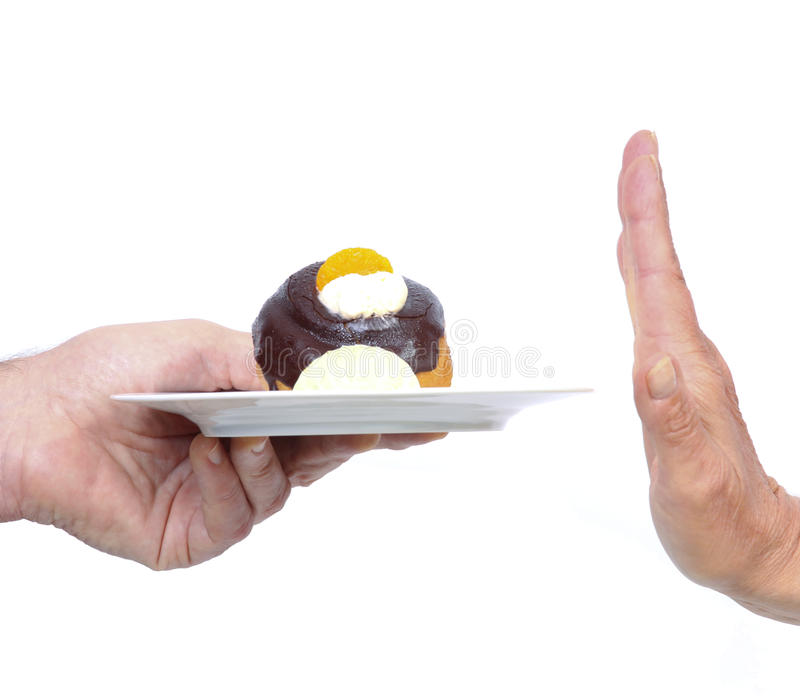 Hand refuses cake stock photos