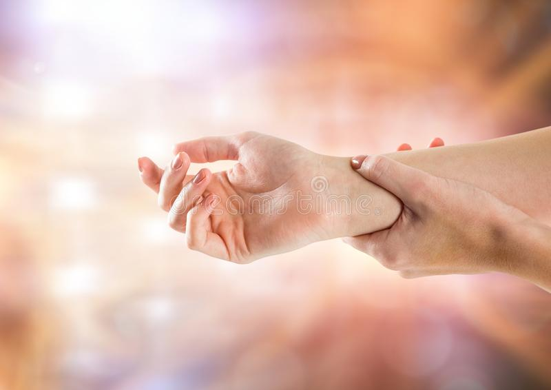 Hand restraining arm with sparkling light bokeh background royalty free stock image