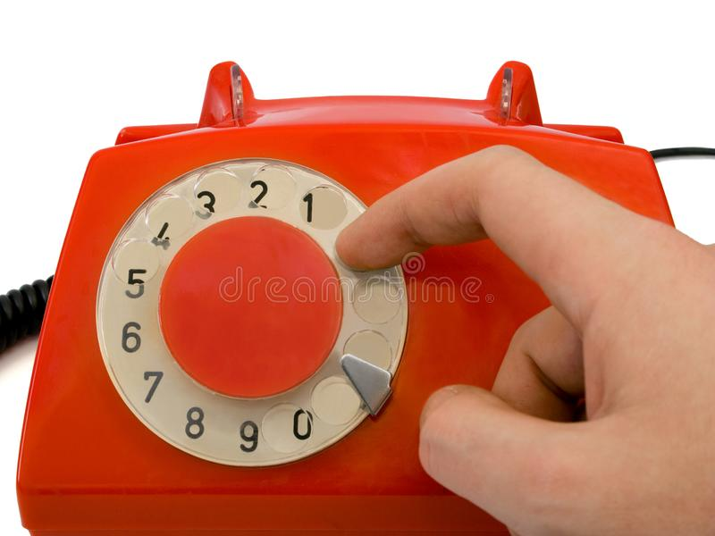 Hand and retro telephone stock photo