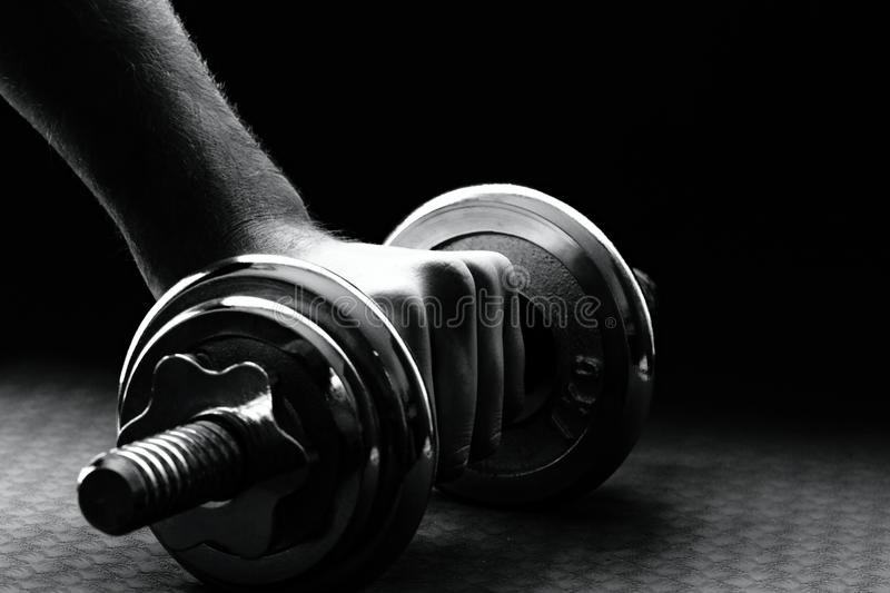 Download Hand Rises Dumbbell Stock Photo - Image: 83709031