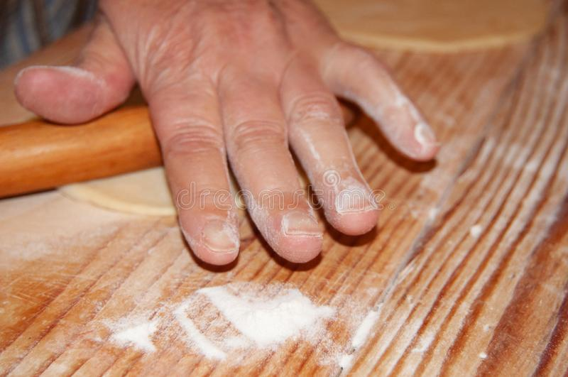 Hand rolling dough and preparing cookies stock photo