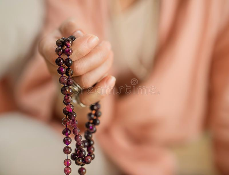 Hand with rosary beads royalty free stock photography