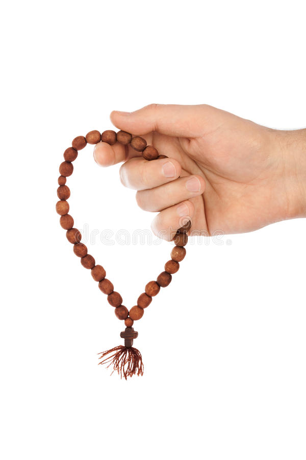Hand with rosary royalty free stock image