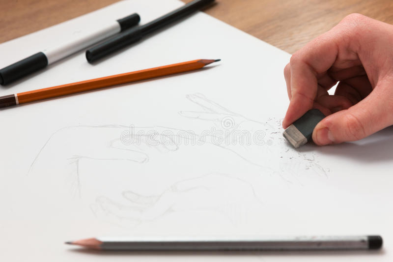 Hand rubbering the draw royalty free stock image