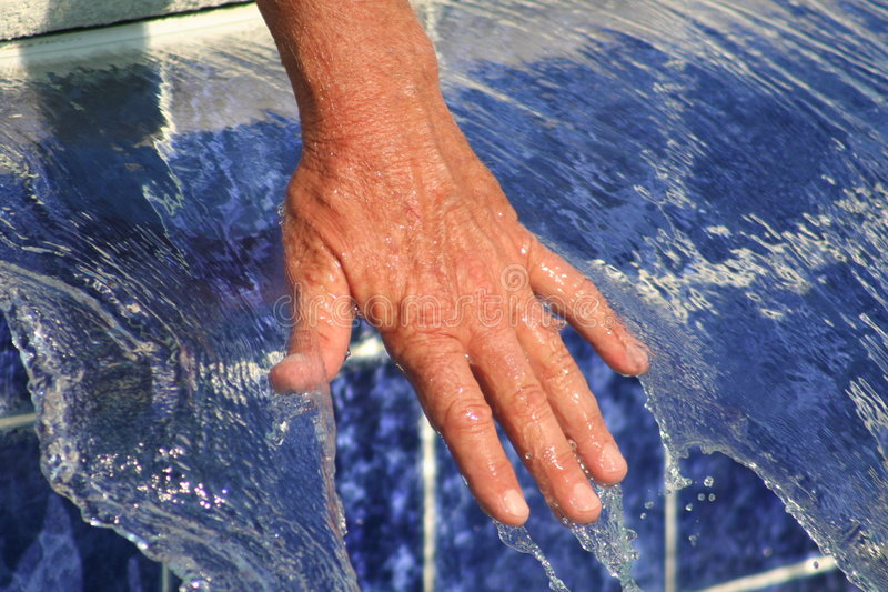 Hand in Running Water royalty free stock photo