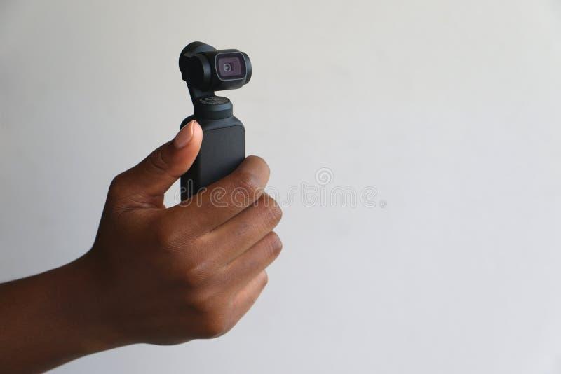 Hand - rymd kamera för osmodjifack royaltyfri fotografi