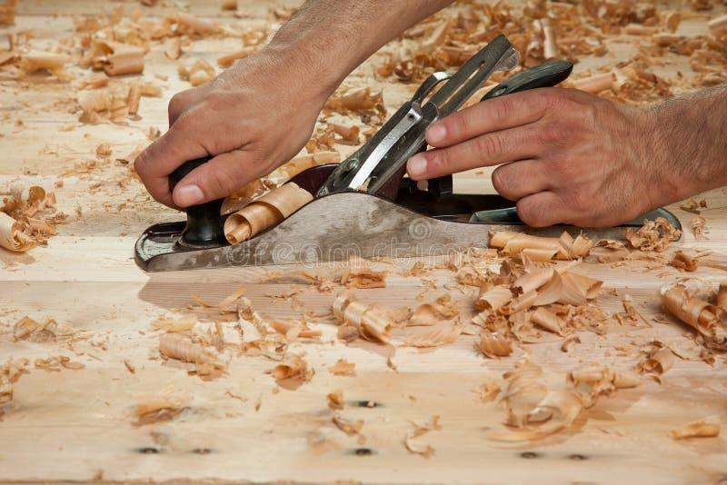 Hand - rymd wood hyvlare royaltyfri foto