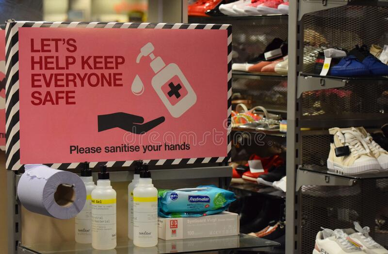 A hand sanitising station in a retail clothing store on the weekend that wearing face coverings became law in England stock photography