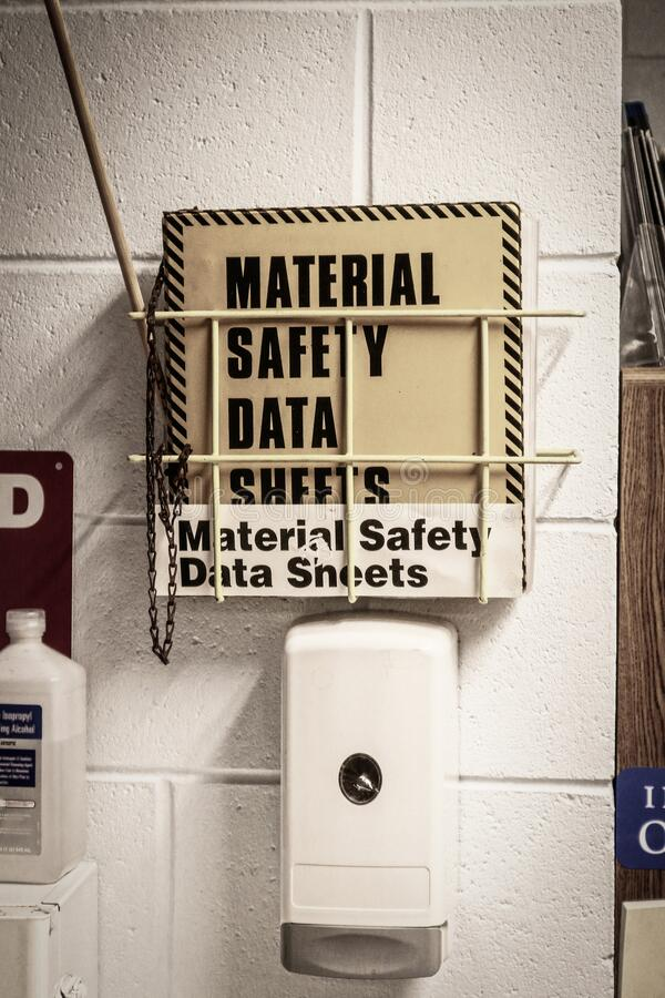 Free Hand Sanitizer And Msds Safety Data Sheets Mounted On Concrete Block Wall In Work Place Royalty Free Stock Photography - 212432507