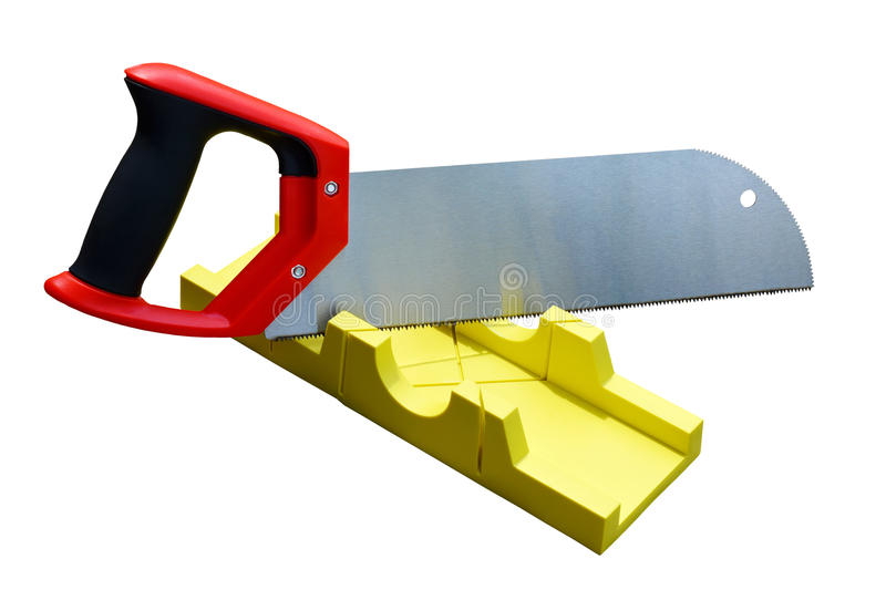 Hand saw and a yellow miter box to make precise mitre cuts. royalty free stock photo
