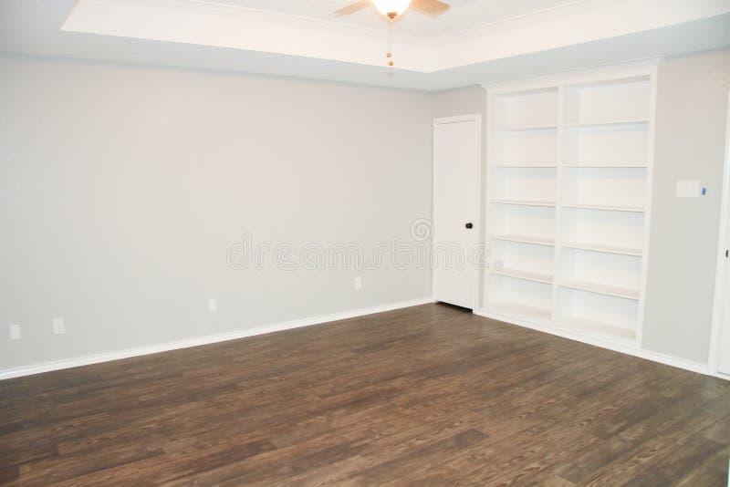 Hand Scraped Hardwood Floors. Hand scraped dark hardwood flooring royalty free stock photo