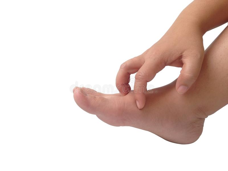 Hand scratching foot on white background. stock photography