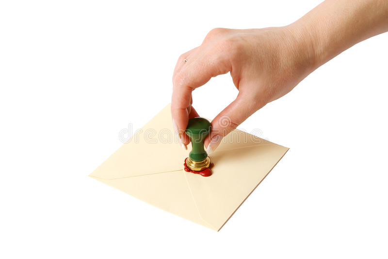 Hand with sealing wax stock photos