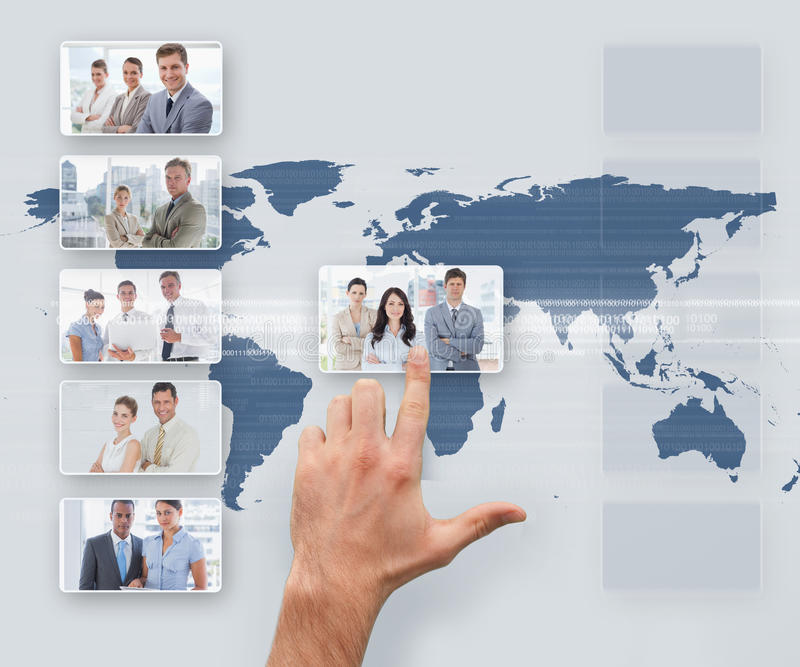 Hand selecting digital interface. Showing business people stock image