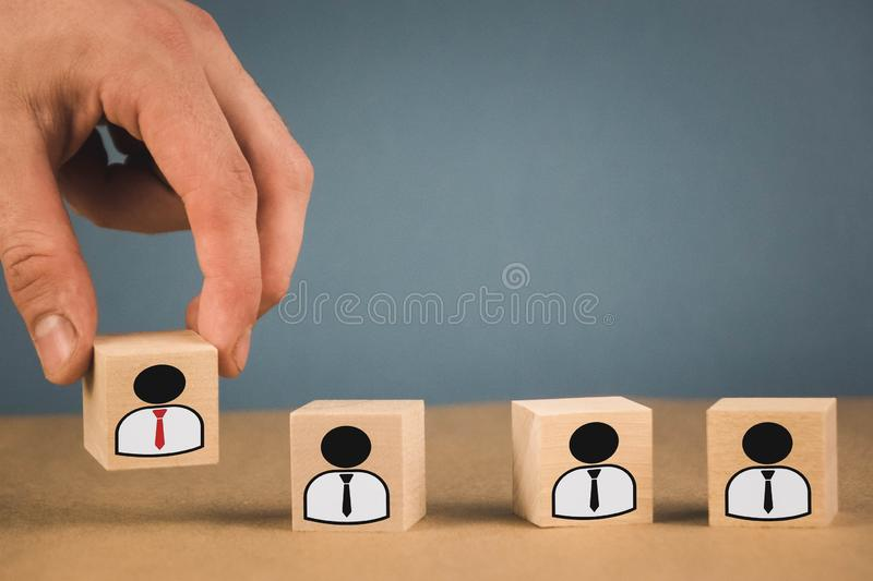 the hand selects personnel among the crowd, which means that the appointment of a figure to a new position royalty free stock photos