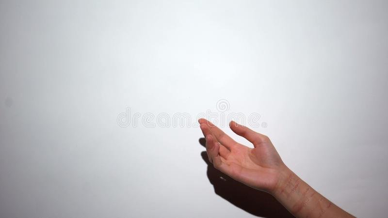 Hand of self-inflicted female asking help, person suffering mental disease. Stock photo stock photo