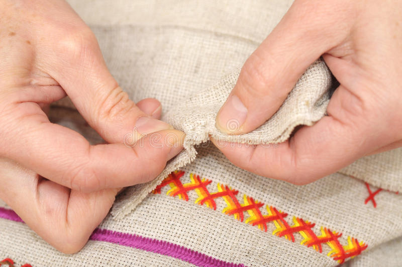 Hand sewing with needle. Woman hands sewing with needle and thread royalty free stock photography