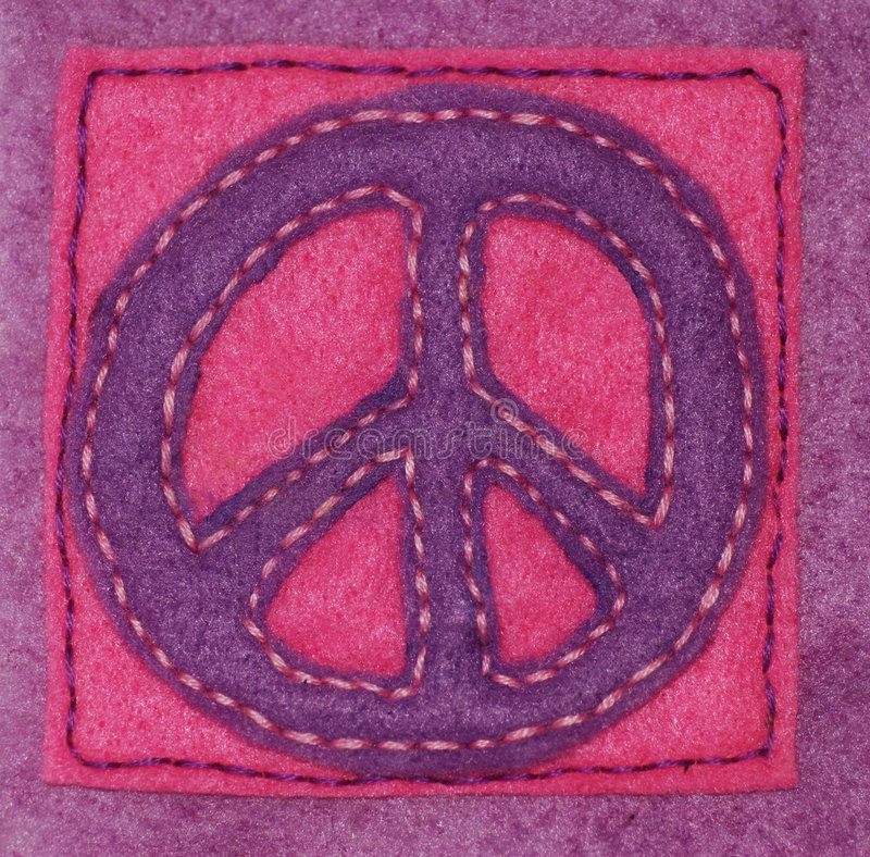 Hand-sewn Peace Sign. An anti-war symbol hand sewn on felt stock image