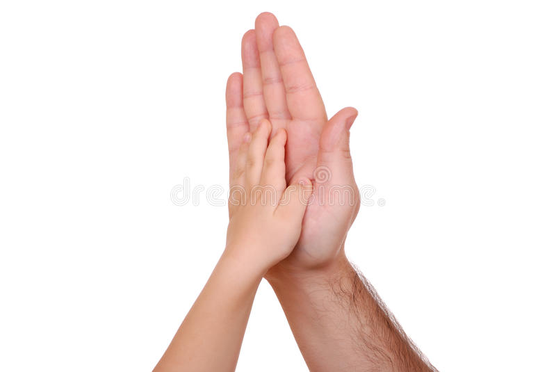 Hand shake of the child and father. Isolated stock photo