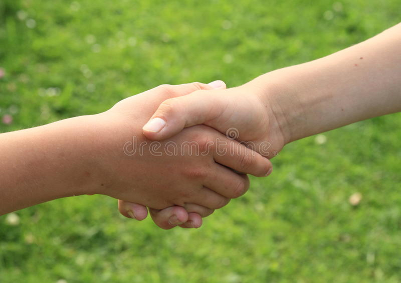 Hand shake. Children hands shake each other for freindship royalty free stock photography