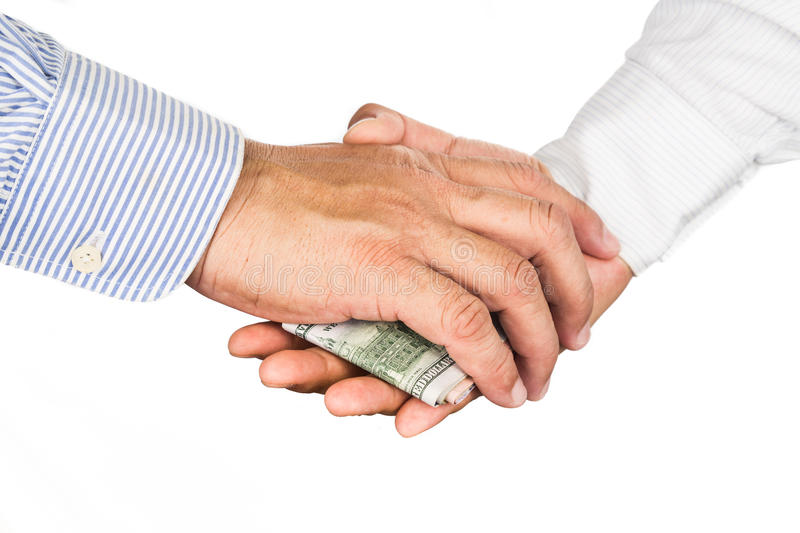 Hand shake deal with corrupt cash exchange.  stock image