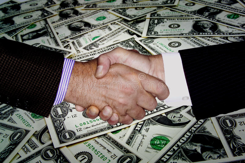 MONEY FINANCIAL PLANNING WEALTH MANAGEMENT RETIREMENT FUND. Two businessmen shaking hands, financial planning wealth management money investment background royalty free stock photography