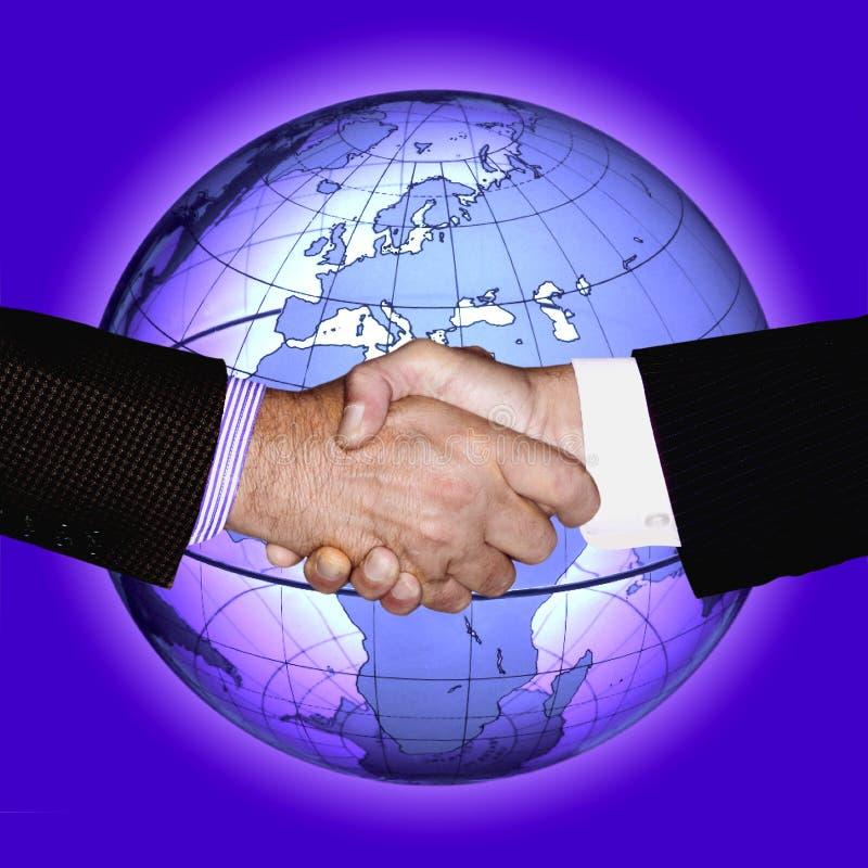 BUSINESS PEOPLE SHAKING HANDS WORLD INTERNATIONAL stock photo
