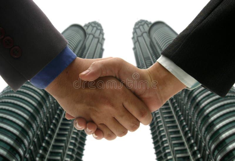 Hand shake at KLCC stock images