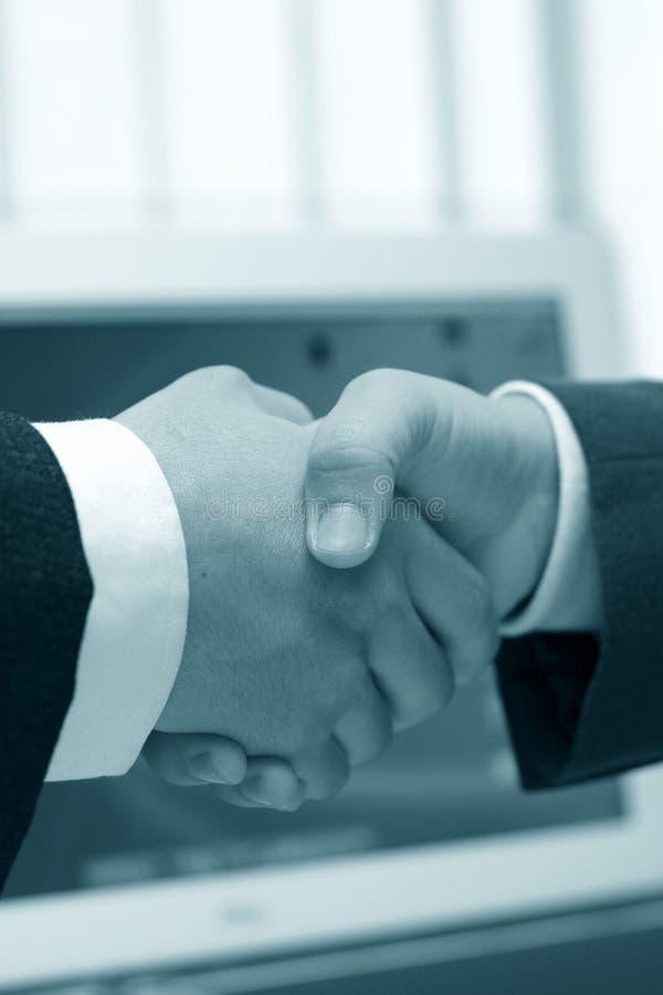 Hand shake at office royalty free stock image