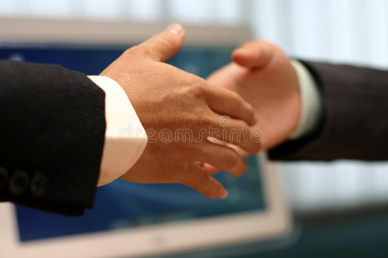 Hand shake at the office stock photo