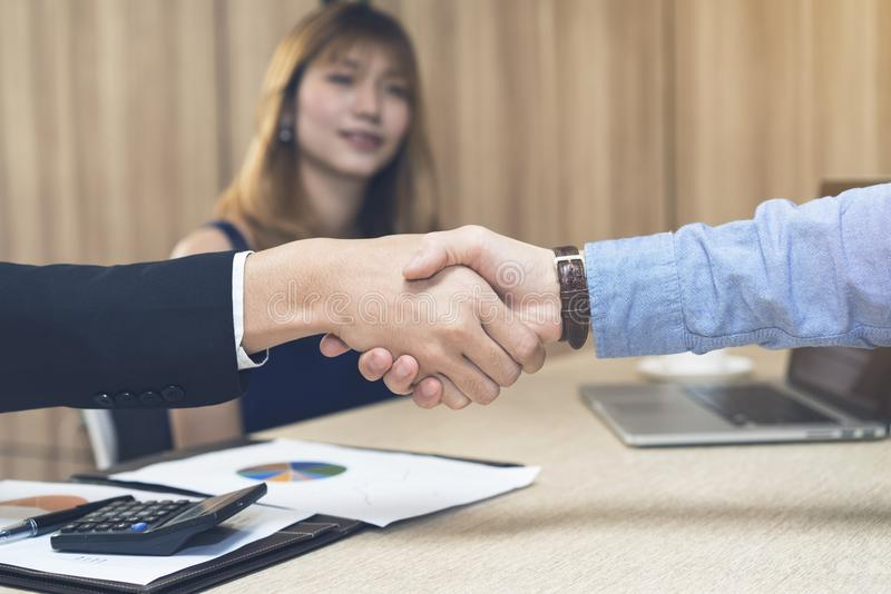 Hand shake between two businessmen in the meeting room royalty free stock photos